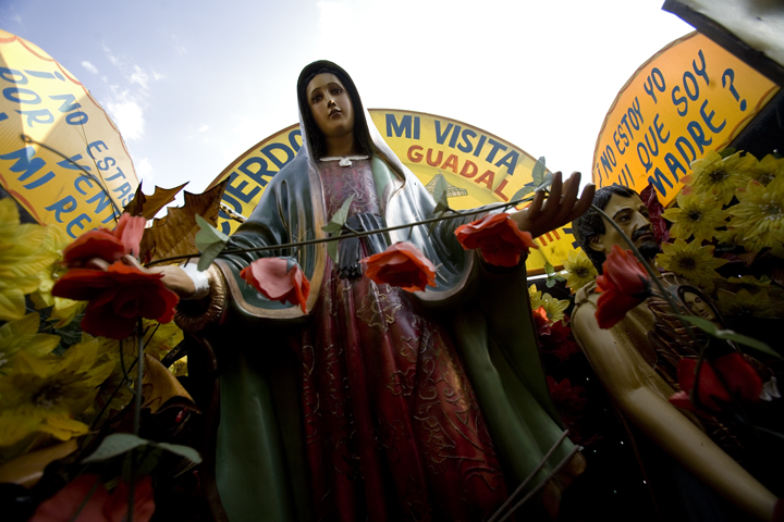 A Virgen de Guadalupe statue, used for tourist photos at the Basilica de Guadalupe in Mexico City, Mexico, is put in storage during swine flu in April 2009.