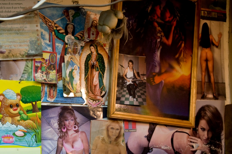 A printer in El Centro has place a Virgen de Guadalupe alongside photos of naked women that he collects.