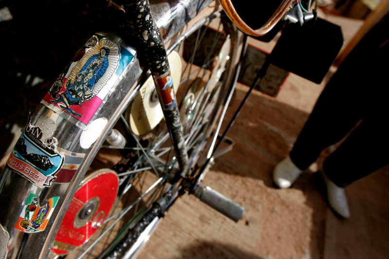 El Bulico (the rooster as he is known in town) shows off his bike decorated with decals of the Virgen of Guadalupe and anything else he's found while working in the states from the past thirty years.