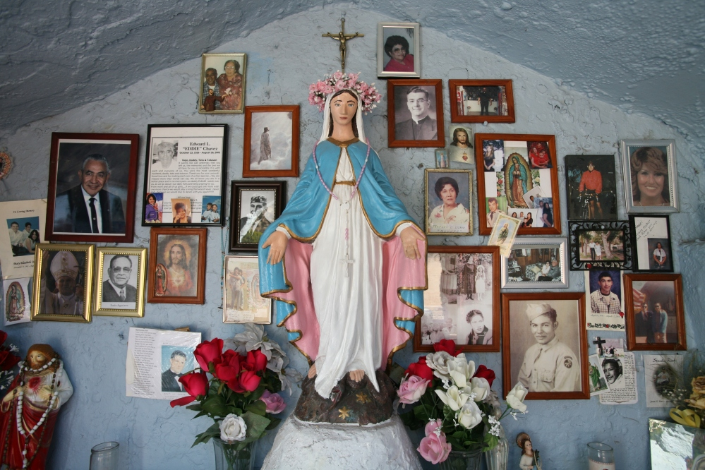 To the right of the traditional Virgin Mary image is an image of the Virgen of Guadalupe in Miami, Arizona.