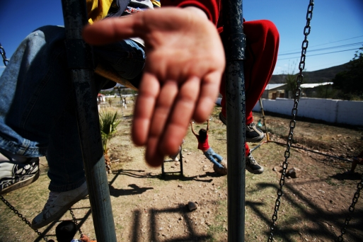 Children play on slides and swings at Casa de Elizabeth Orphanage in Imuris, Sonora, Mexico.