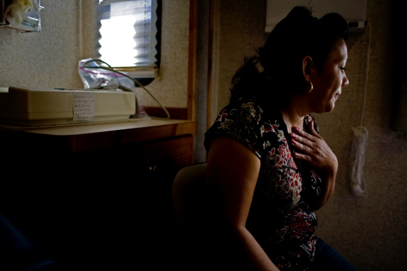 A mother of three is seen by physicians at Mission of Mercy mobile clinic in West Mesa, Ariz.