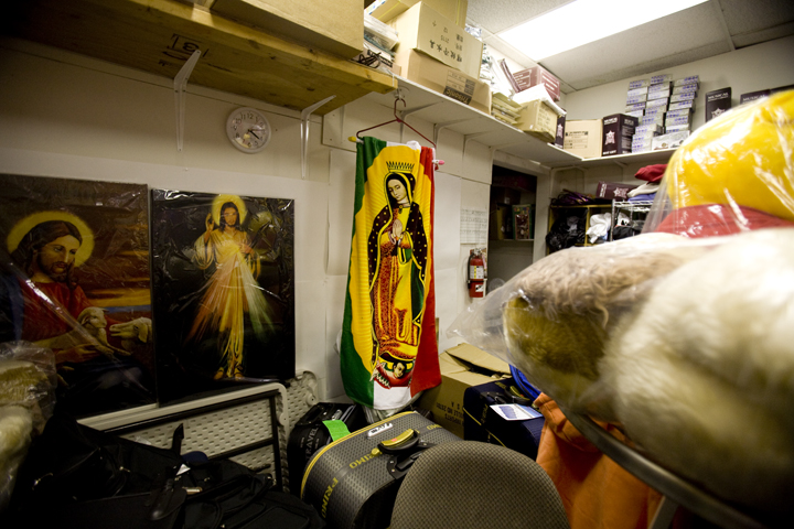 A Virgen of Guadalupe blanket sits in the back of a dollar store owned by a Chinese family in Washington D.C.