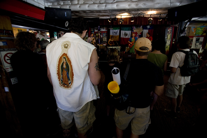 A man wears a cut off t-shirt with her image in a bar in Austin, Texas.