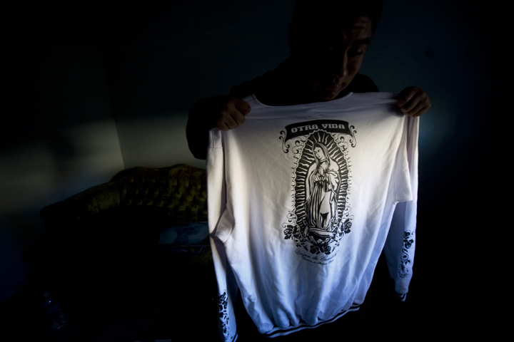 The sweatshirt featuring the Virgen of Guadalupe is from a clothing line based in Japan where a lowrider culture and appreciation for Chicano art has thrived for the past twenty years.