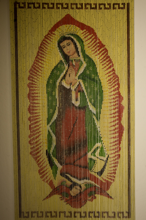 A Virgen de Guadalupe made in Vietnam hangs in the home of Anita Madrigal, who collects her image, in Woodland, California.