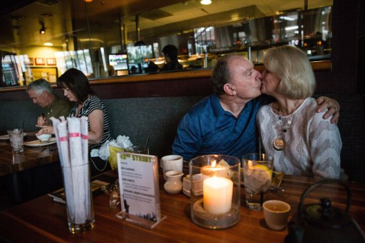 TEMPE - April 6, 2016 - ASU Now - Tempe - Marine Corps veteran Ray Cook gives his wife Christa Cook a kiss following their meal at P.F. Chang's during Operation Date Night in Tempe on April 6, 2016. Operation Date Night gives 50 veterans and a guest a dinner provided by downtown Tempe restaurants and tickets to 42nd Street as a thanks for their service. Photo by Deanna Dent/ASU Now