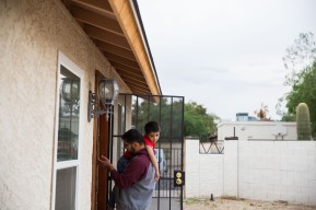 PHOENIX - April 13, 2016 - ASU Now - Sayed Karimi picks up his sad nephew Mansour Karimi as he takes him in following their time playing outside at his home in North Phoenix Wednesday afternoon on April 6, 2016. Photo by Deanna Dent/ASU Now