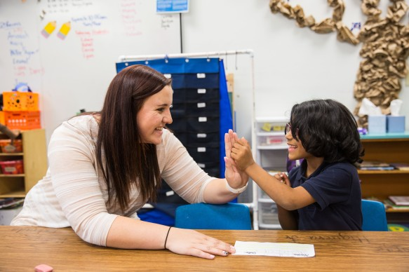Phoenix - April 21, 2016 - ASU Now - Senior student teacher Paige Pritts high fives Lyan Al-Shawi after she completes her sentence in Rachel Wade's kindergarten class at Balsz Elementary School in Phoenix Thursday afternoon on April 21st, 2016. The student teachers are part of a new program where they visited students at their home. Photo by Deanna Dent/ASU Now
