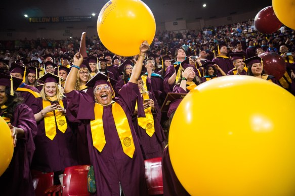 TEMPE - May 9, 2016 - ASU Now - Wells Fargo Arena - Masters in Social Work graduate Peggy Sue Gamble cheers following the end graduate commencement on Monday morning May 9, 2016. Photo by Deanna Dent/ASU Now