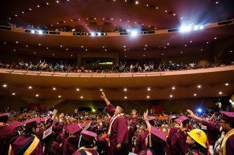 Tempe - May 11, 2016 - ASU Now - American Indian Convocation - Graduates stand and cheer their family during the American Indian convocation at ASU Gammage on Wednesday, May 11, 2016. Photo by Deanna Dent/ASU Now