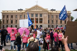 30217962A - AZ VOLUNTEER 1 - 03/24/2018 Planned Parenthood volunteers stand in between pro-gun protestors and attendees of the March for Our Lives at the Arizona state capital in Phoenix, Ariz. Saturday morning March 24th, 2018. Deanna Alejandra Dent for The New York Times