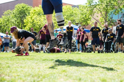 ASUNow - ASU-ATF Kick-Off Event - 4/20/2018 Athletes do medicine ball burpees while competing in an obstacle course relay race during the ASU-ATF Kick-Off event on Tempe campus Friday morning on April 20th, 2018. ASU will be working with the Adaptive Training Foundation and this is their first event together. Photo by Deanna Dent/ASUNow