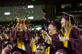 ASU Now - Undergraduate Commencement Ceremony Spring 2018 - Wells Fargo Arena - 5/7/2018 (from left to right)Education graduates Gabriela Strunk, Katrina Paluzzi and Oksanna Scheidt celebrate with confetti during undergraduate commencement at Chase Field in Phoenix Monday evening May 7th, 2018. Photo by Deanna Dent/ASUNow