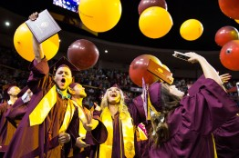ASU Now - ASU Now - College of Health Solutions convocation - 5/11/2018 Exercise and wellness graduates Jeremy Acre, left, and Levia Nguyen, second from left, cheer after receiving their degrees during the College of Health Solutions convocation Friday evening May 11th, 2018. Photo by Deanna Dent/ASUNow
