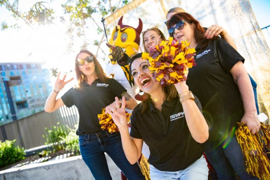 ASU Now - Innovation Day 2018 - November 16th, 2018 - Sun Devil Stadium **photo released or staff** The EdPlus team poses for a photo with Sparky at the EdPlus booth during the first Innovation Day on Friday evening at Sun Devil Stadium November 16th, 2018. Photo by Deanna Dent/ASU Now